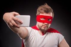 Человек супергероя делая фото Стоковая Фотография RF
