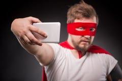 Человек супергероя делая фото Стоковые Фото