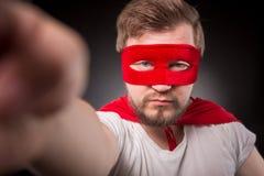 Человек супергероя делая фото Стоковая Фотография
