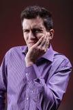 Человек с болью зуба Стоковые Изображения