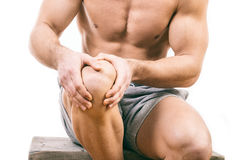 Человек с болью колена стоковая фотография rf