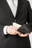 Человек с деньгами наличных денег евро Стоковое Изображение