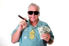 Человек с деньгами Человек выигрывает деньги Человек имеет деньги Человек обнюхивает деньги Человек любит деньги Человек и его де стоковые изображения rf
