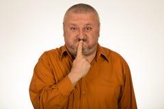 Человек с жестом shh и безмолвием Стоковая Фотография RF