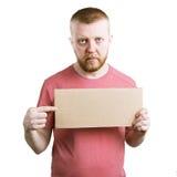 Человек с знаком в его руке стоковое фото