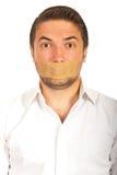 Человек с клейкая лента для герметизации трубопроводов отопления и вентиляции над ртом Стоковая Фотография RF