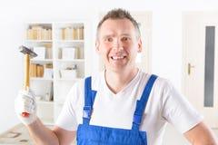Человек с молотком дома или офисом стоковое фото rf