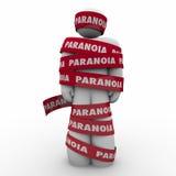 Человек слова паранойи обернул беспокойство стресса ленты тревоженое Стоковое Фото