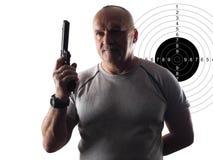 Человек с оружием и целью Стоковое фото RF