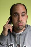 Человек с пробуренным выражением на его стороне Стоковые Фотографии RF