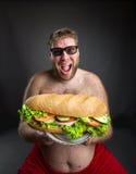 Человек с сандвичем Стоковые Изображения RF