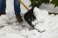 Человек с снегоочистителем Стоковое фото RF