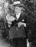 Человек с сумкой полной наличных денег (все показанные люди более длинные живущие и никакое имущество не существует Гарантии пост Стоковое Изображение