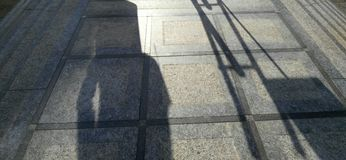 Человек с тенью гитары Стоковые Фотографии RF