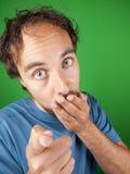 Человек с удивленным выражением указывая на вас Стоковая Фотография RF