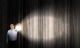 Человек с фонариком Стоковая Фотография