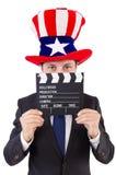 Человек с шляпой США и кино всходят на борт изолированный Стоковая Фотография