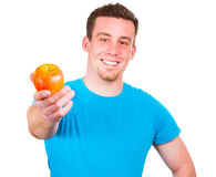 Человек с яблоком в его руке Стоковые Изображения RF