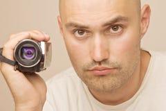 Человек с videocamera дилетанта цифровым Стоковые Изображения