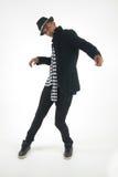 Человек танцев одетый умно Стоковая Фотография