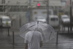 Человек токио в дожде Стоковое Фото