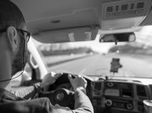 Человек управления рулем Стоковое Изображение