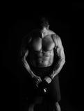 Человек фитнеса колокола чайника Стоковое Изображение