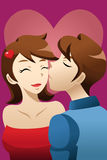 Человек целуя его подругу Стоковое фото RF