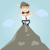 Человек шаржа на верхней части горы Стоковое Изображение