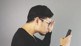 Человек Asain с серой предпосылкой стоковое фото rf