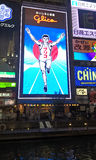 Человек Glico, светлая афиша в торговой улице Dotonbori, Осака, Японии Стоковое Фото