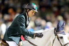 Человек patting его лошадь стоковые изображения rf
