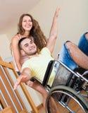 Человек Smailing на кресло-коляске Стоковые Изображения RF