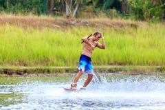 Человек Wakeboarding Стоковые Фото