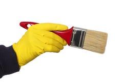 Человеческая рука в paintbrush владением перчатки Стоковые Фотографии RF
