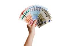 Человеческая рука держит банкноты евро Стоковое фото RF