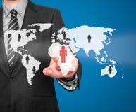 Человеческие ресурсы бизнесмена касающие подписывают - HR, HRM, концепцию HRD Стоковые Изображения