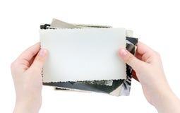 Человеческие руки держа серию винтажных фото изолированных на whit Стоковая Фотография