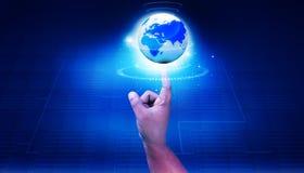 Человеческий пункт руки к цифровому миру Стоковое фото RF