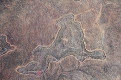 Человеческое звероловство на стене песчаника Стоковая Фотография RF