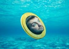 Человеческое лицо в монетке Стоковое Изображение