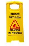 Чистка знака пола предосторежения влажная в изоляте знака прогресса на белой предпосылке Стоковые Фотографии RF