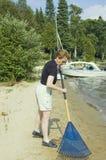 чистка пляжа стоковое изображение