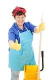 чистота дает большие пальцы руки горничной вверх стоковое фото rf