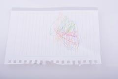 Чистый лист бумаги scribbled с карандашами цвета Стоковые Изображения