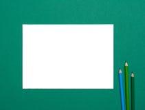 Чистый лист и карандаши Стоковая Фотография