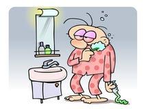 чистящ его утомлянные зубы щеткой человека Стоковая Фотография RF