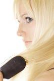 чистя щеткой волосы Стоковое фото RF