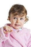 чистя щеткой девушка ее маленькие зубы Стоковое Изображение