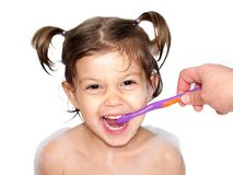 чистя щеткой зубы Стоковые Фото